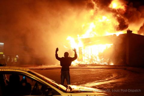 Photojournalist reflects on Ferguson one year after unrest via @NBCBLK