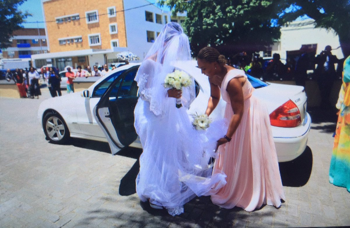 #Wedding Bride #ZizoBeda being assisted by Asanda Matsaunyane outside the St Saviours Anglican Church in East London https://t.co/TX1tWgavF6