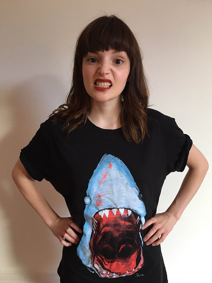 Our @CHVRCHES shark tee by @Iain_A_Cook now instock! Here's @laurenevemay showing us hers!