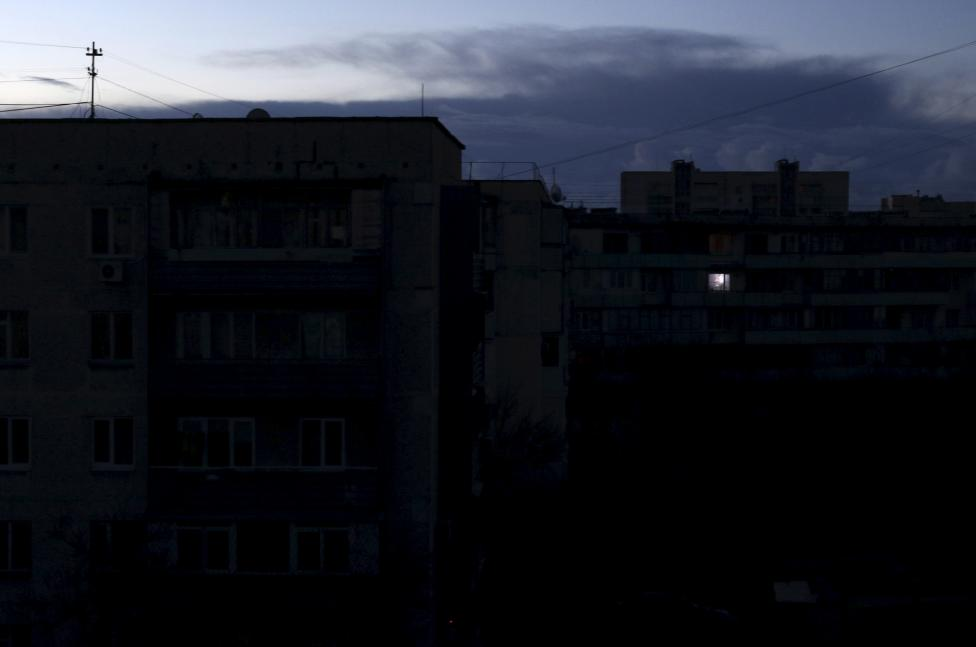 A single light illuminates a room during a blackout in Crimea. Editor's Choice: