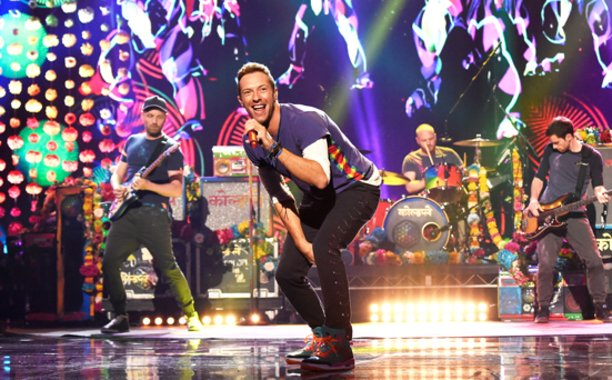 EW : Coldplay frontman, Chris Martin, is designing the Super Bowl 50 Halftime...