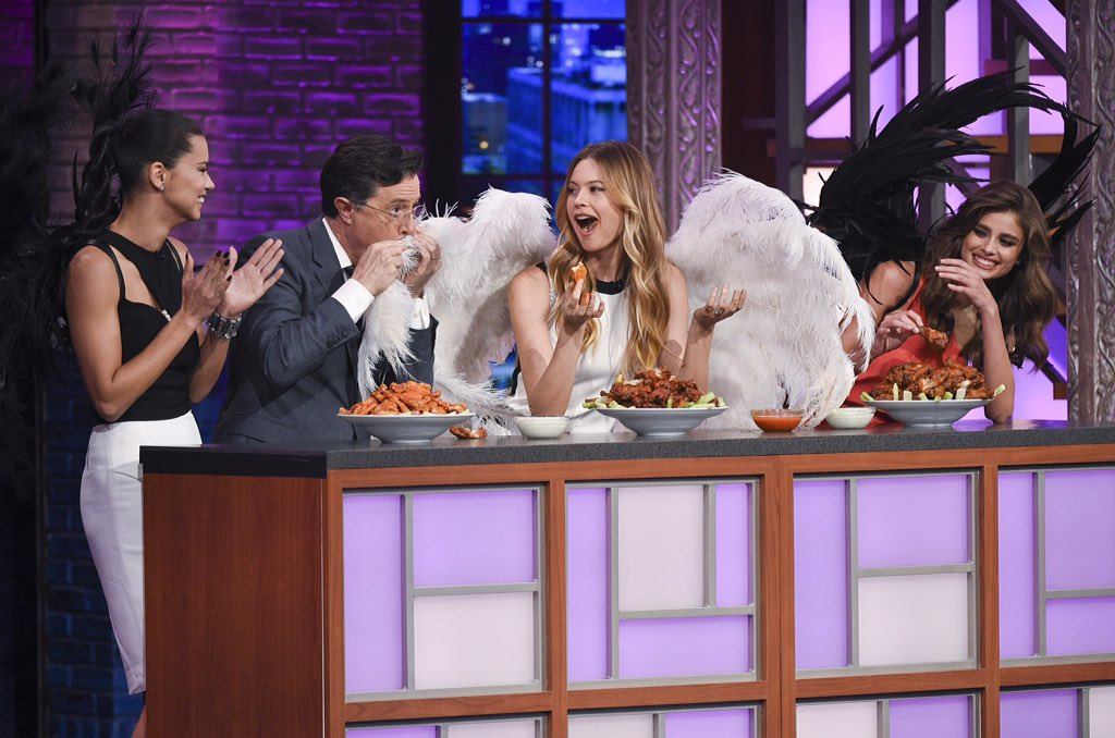 Bring a napkin next time, @StephenAtHome! The Angels + wings on @colbertlateshow. ???? #VSFashionShow https://t.co/TlIeFRClf0