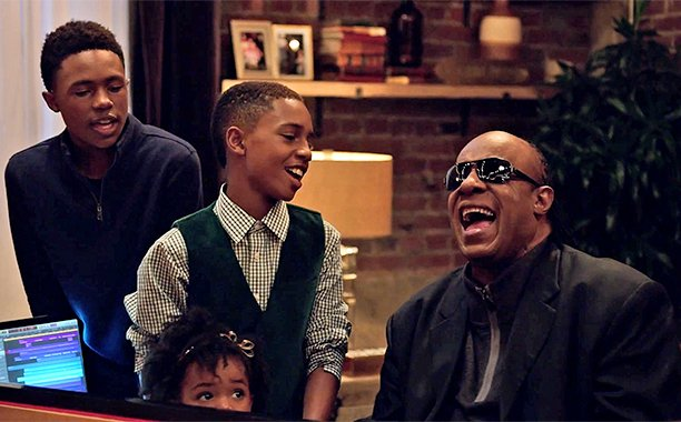 Yup, that was Stevie Wonder & Andra Day covering a Christmas classic in an Apple commercial: