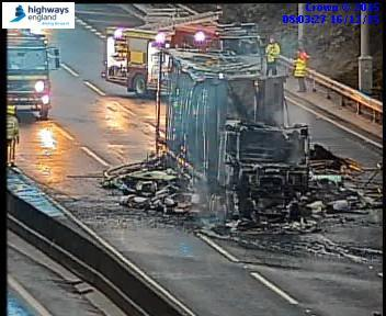 #M62 e/b closed J29-J30 following intense lorry fire. Damaged rd has been resurfaced. We hope to re-open after 10pm. https://t.co/SyyQ4aMADM