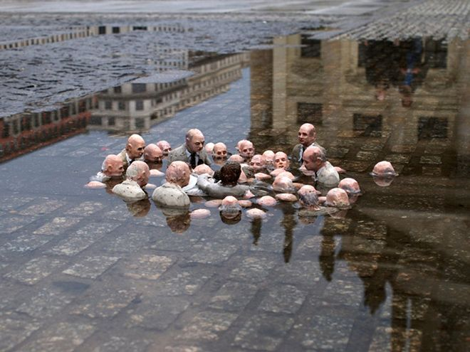 """As David Cameron visits the flooded north let's revisit """"Politicians discussing climate change"""" by Isaac Cordal. https://t.co/X086wi0G6h"""