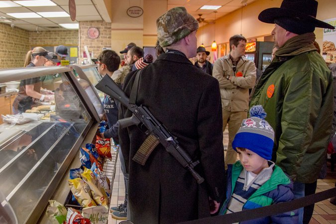 New open carry law in Texas--a Dad with AK pointed at his kid. May be loaded and safety off (NYT photo).  https://t.co/AYrUuQaWND