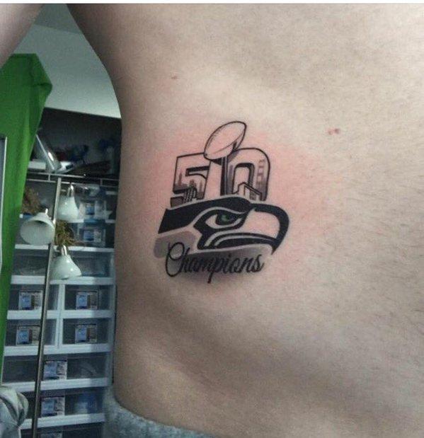 I bet this Seahawks fan regrets this tattoo... #Seattle #SEAvsCAR #SeattleSeahawks https://t.co/VAuF8NEwTC