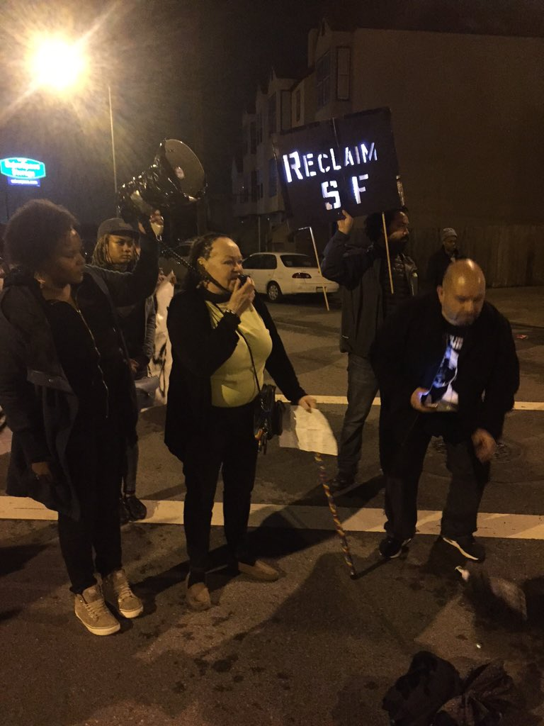 At Bayview #sfpd station in pouring rain @j4alexnieto @Justice4MWNow #alexNieto #MarioWoods #last3percent #ReclaimSF https://t.co/XL12LJ04gJ