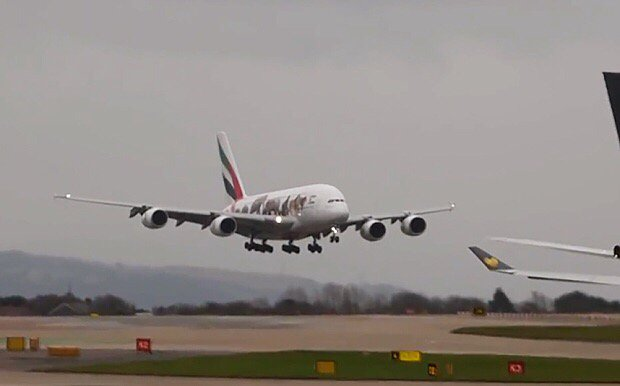 Emirates A380 turbulent touchdown as it struggles with crosswinds at Manchester Airport
