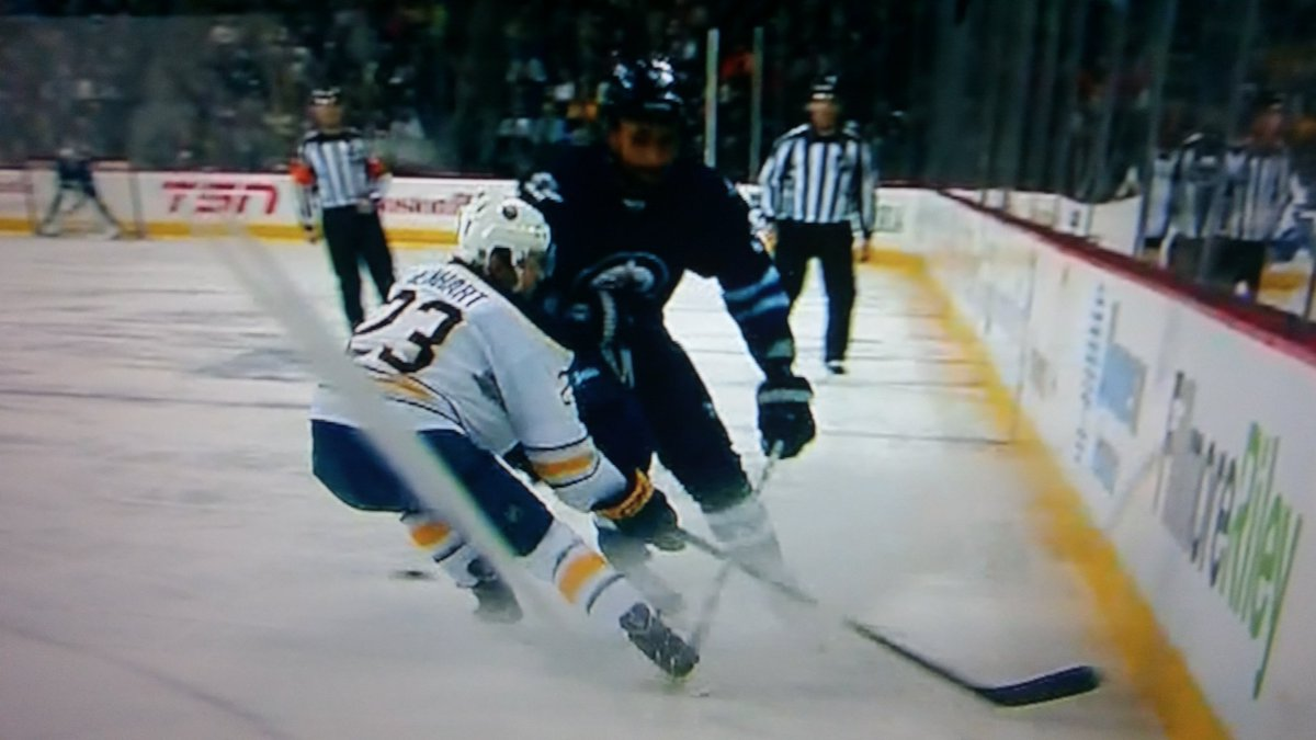 Byfuglien Rule 48 Violation on Reinhart. Principle point if contact 23's head. No call by 2 refs watching the play https://t.co/190YPkzclF