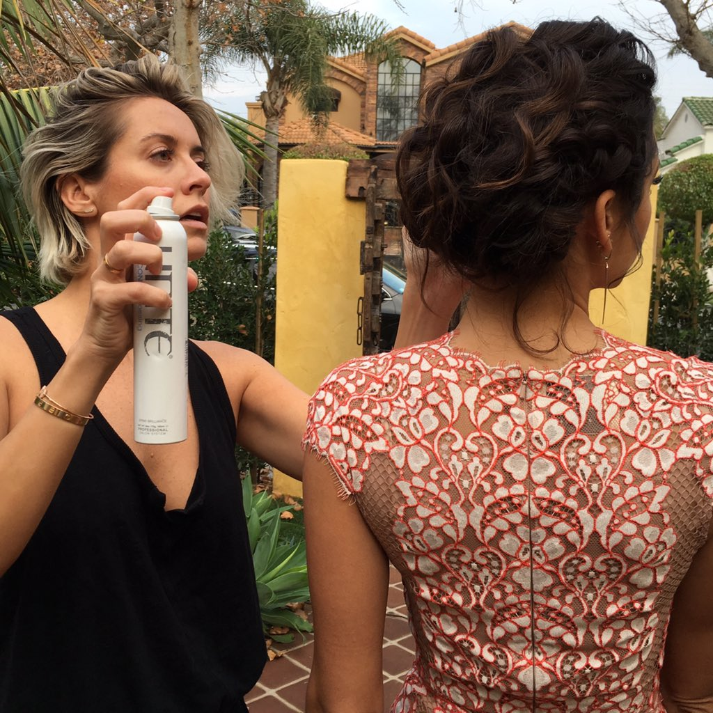 @RiawnaCapri adding the finishing touches to @ninadobrev's #GoldenGlobes hairstyle! Step-by-steps to come!