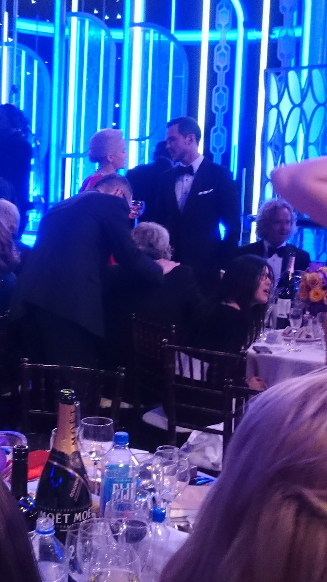 Yes, that's JLaw talking to ex Nicholas Hoult during the first commercial break. #GoldenGlobes https://t.co/2BMMbLeKND