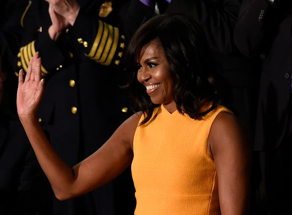Mrs. O looks lovely in a wool crepe dress by @NarcisoStudio at tonight's #SOTU; color name is marigold … https://t.co/LpxmTLrdho