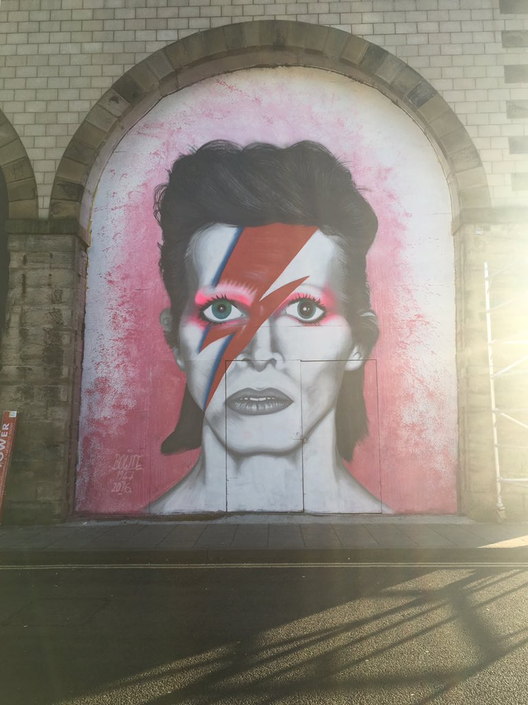 Check out this amazing #Bowie tribute by one of our @_CoMusica project artists in the arches behind the building! https://t.co/8Ohj4Ugj2k