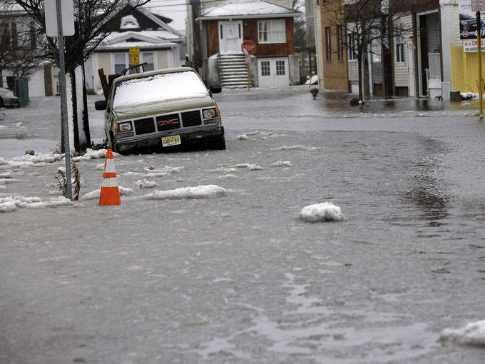 Trapped Jersey shore resident compares floodwaters to Japan tsunami. (AP photo)