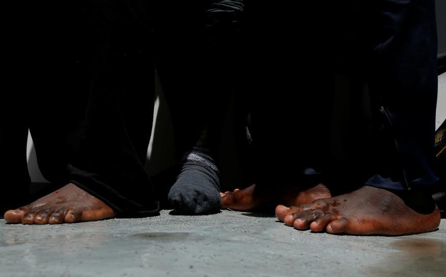 Libya-based smugglers kill man for baseball hat, rescued migrants say