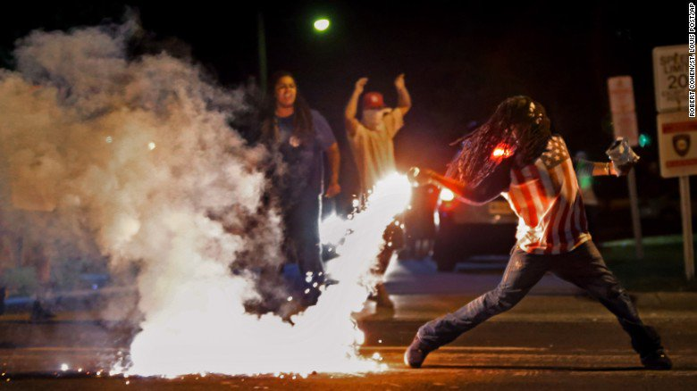 The man who was the subject of an iconic Ferguson photo has died