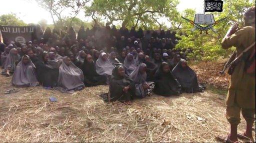 The Latest: 82 freed schoolgirls to meet Nigerian president