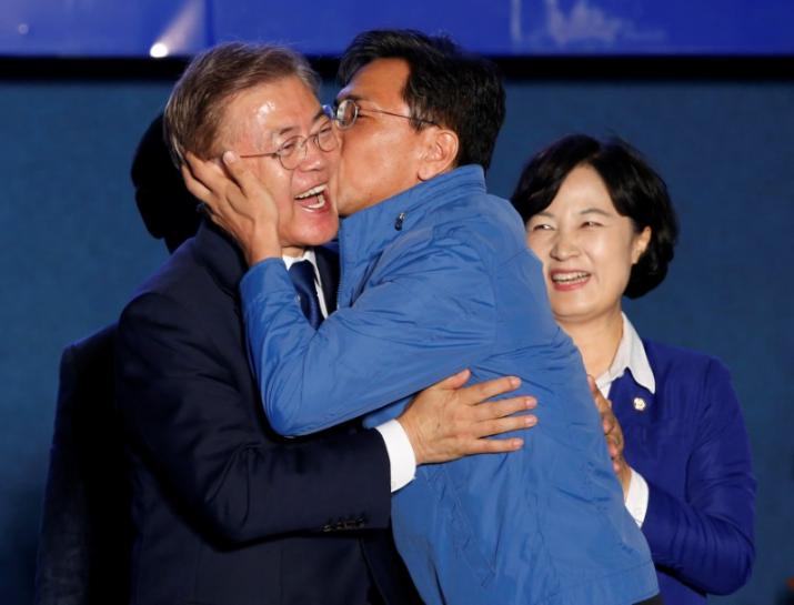 South Korea president winner Moon vows to unify bruised country