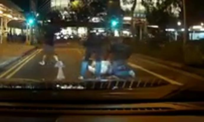 Man pinned down in middle of road at Tampines was 1 of 4 arrested for housebreaking: Police
