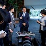 Japan's Abe: Japan had phone calls with South Korea, U.S. on North Korea