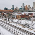 Snow covered train tracks on the South Side run parallel to Carson St. as #Pittsburgh rises into gray skies https://t.co/JhW1LeuDFp