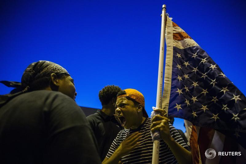 Justice Department sues Ferguson over police reforms: