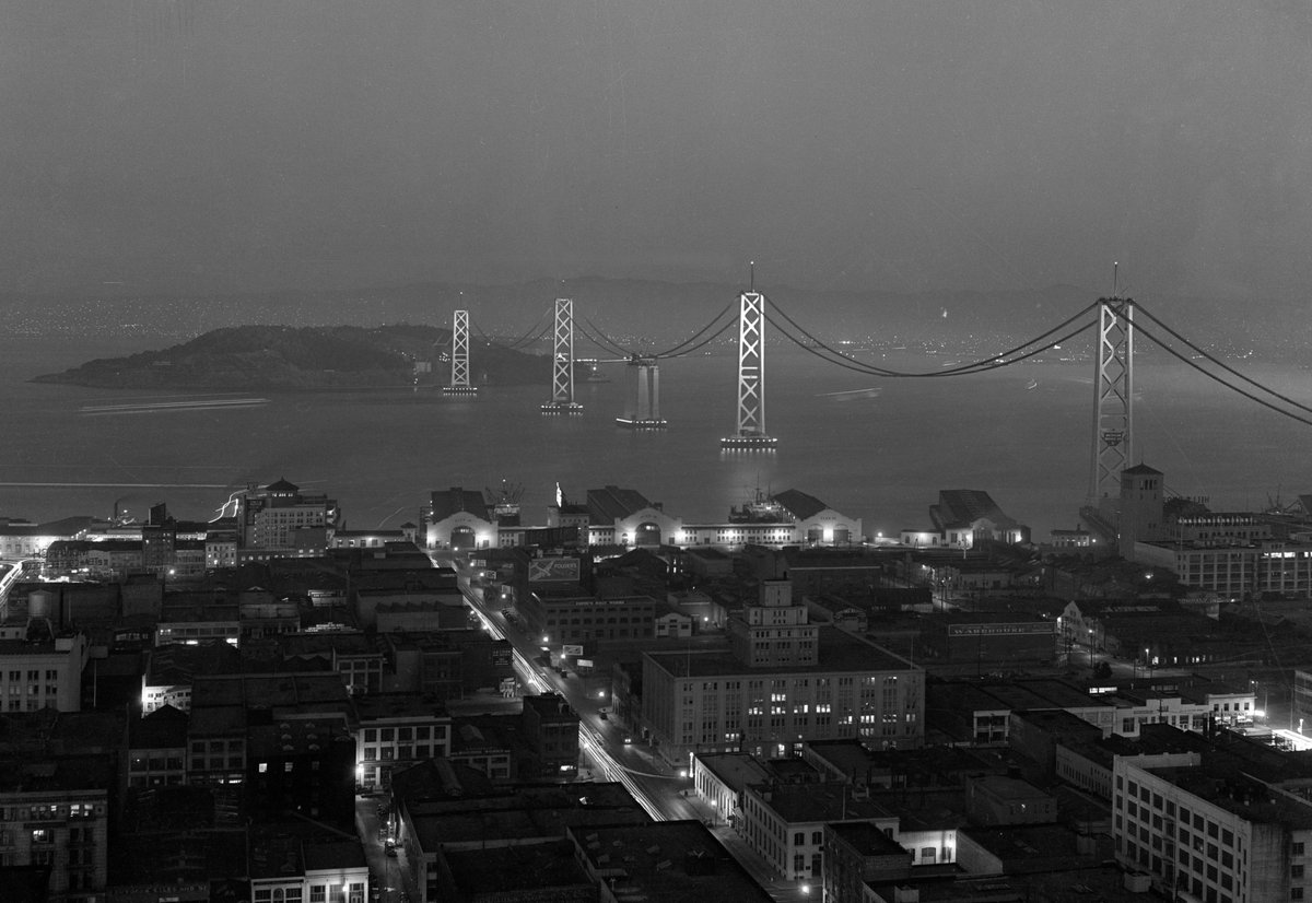 This was a lovely archive find today. Night photo of still-under-construction Bay Bridge and Embarcadero in 1936. https://t.co/tS2wNYxYRa