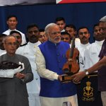 PM @narendramodi being presented a memento by Defense Minister at the International Fleet Review 2016 in Vizag https://t.co/UC0xdCsBuM