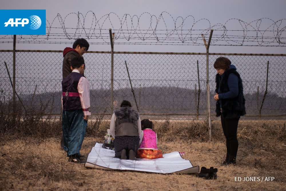 South Korean family prays for relatives in the North near the demilitarized border zone to mark the Lunar New Year