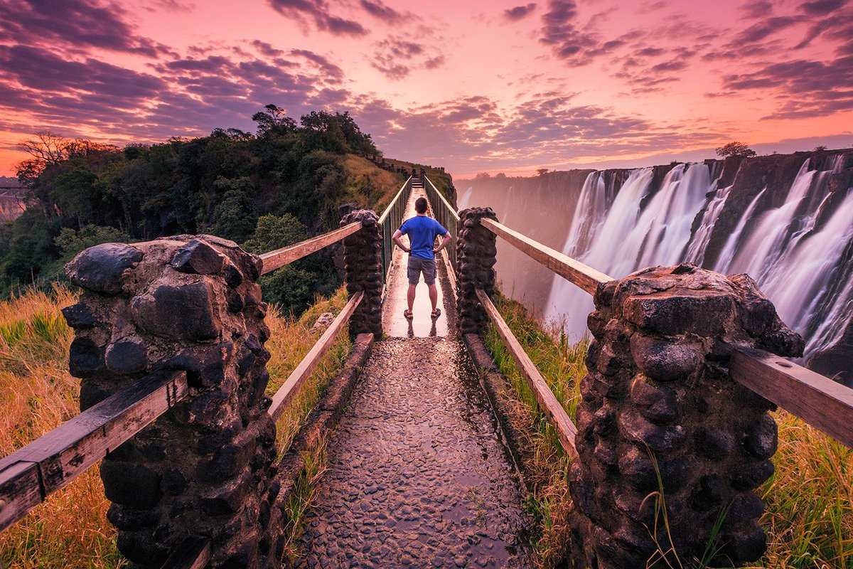 Self-portrait at sunset, Victoria Falls, Zambia. I'm not pretty so I always face AWAY from the camera if possible! https://t.co/YhxQSluBTy