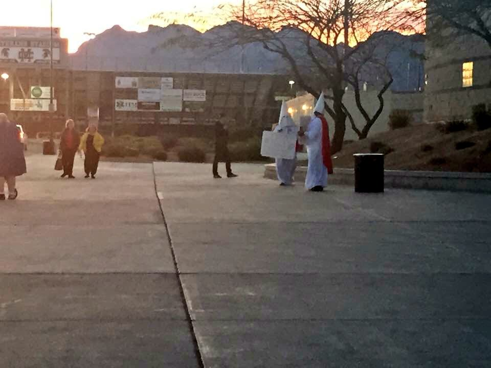 Good god. Two protestors in full KKK garb at Cimarron High in Las Vegas for #NVcaucus. Tipster pic: https://t.co/oxH5dpKjSj