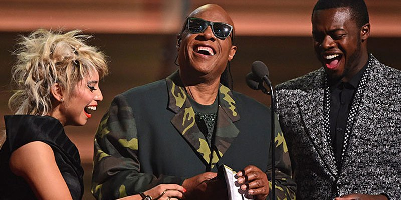 Stevie Wonder holds up braille card at GRAMMYs—promotes accessibility for the disabled