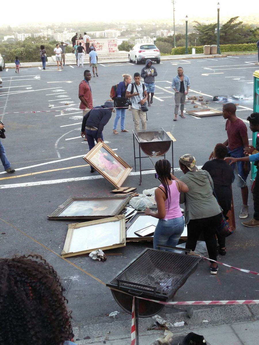 Mayhem on UCT campus as students burn historic paintings ripped from the walls of residences. More to follow. https://t.co/HO3uE9YTJs