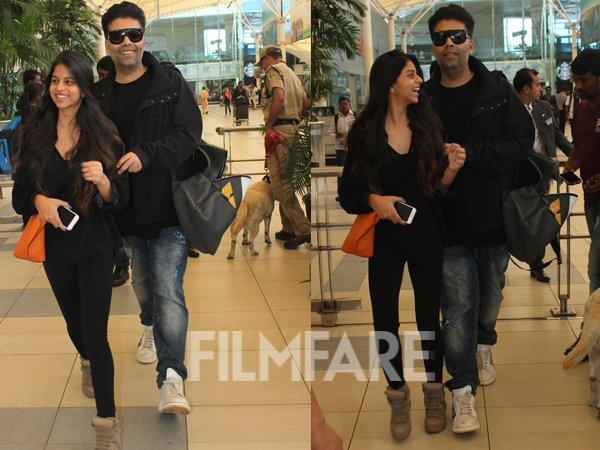 karanjohar and suhana khan snapped in a cheery mood at the airport