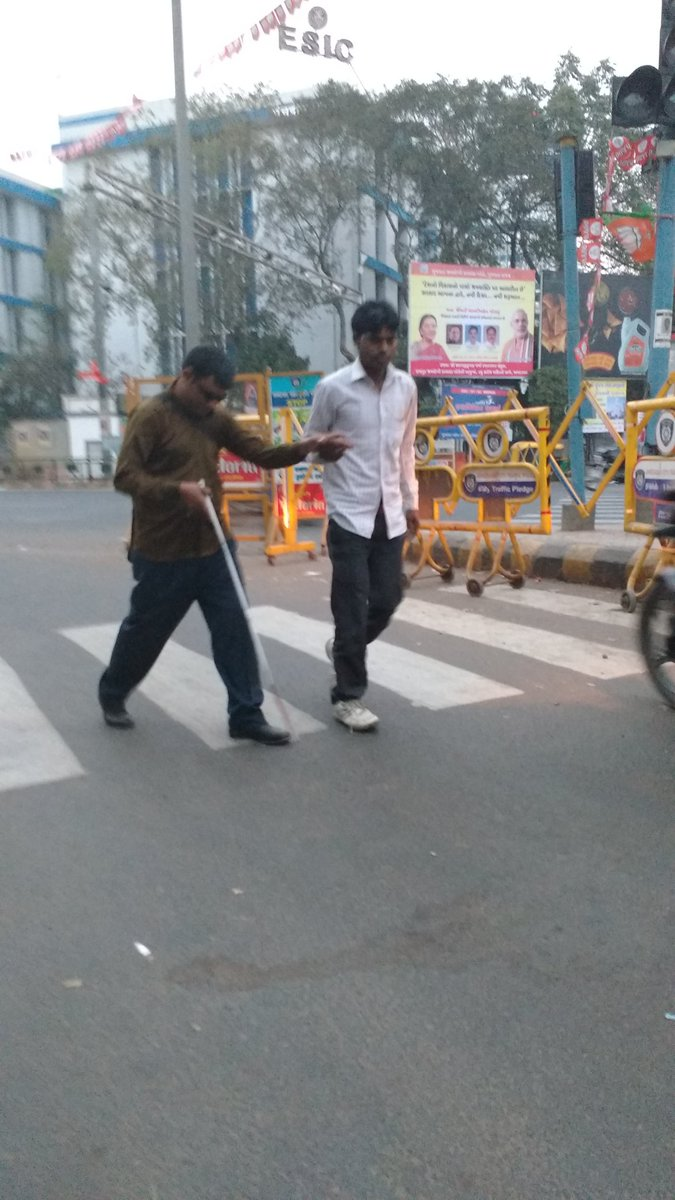 My autodriver stopped and escorted the blind person across traffic. #Ahmedabad https://t.co/yFZcgo8m1a