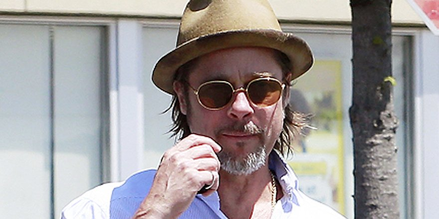 Brad Pitt takes twins Knox and Vivienne pottery painting in London