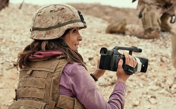 Both the rom & the com fumble to connect in Tina Fey's 'Whiskey Tango Foxtrot.' Our review: