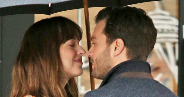 Action! Dakota Johnson and Jamie Dornan share a hot kiss while shooting Fifty Shades Darker: