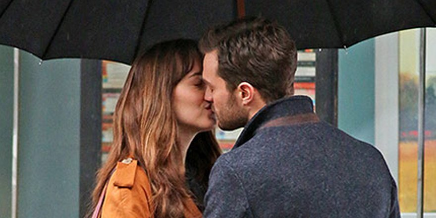 Jamie Dornan & Dakota Johnson kiss on set of Fifty Shades Darker!