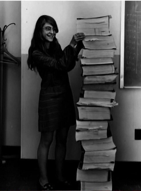 Lead software engineer of the Apollo Project stands next to printout of tweets asking when's International Men's Day https://t.co/jL26tShguY