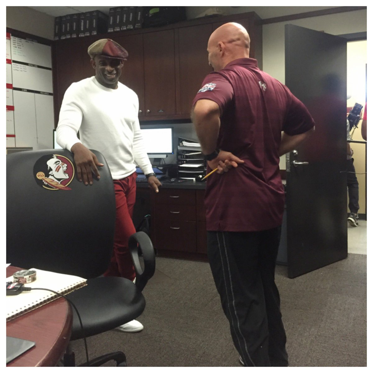 The GOAT is in the building @DeionSanders talking it up with Coach Kelly. Easy to see who the real #DBU is. #Noles https://t.co/xoALUd0MaA