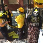Clare Twomey from the Knitting Nannas lock on to the exit of NSW Parliament to protest #csg #nswpol https://t.co/kanznKZJNK