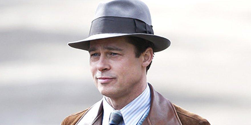 Brad Pitt cuts a dashing figure on the set of his WWII-era drama with Marion Cotillard