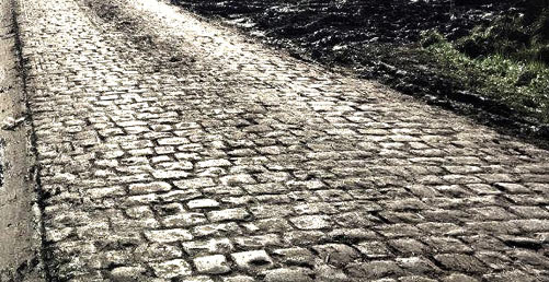 Still going to #Belgium? Yes. There are still cobbles on the Koppenberg; we'll be there. #bikesnotbombs #solidarity https://t.co/tHiJ5DZiug