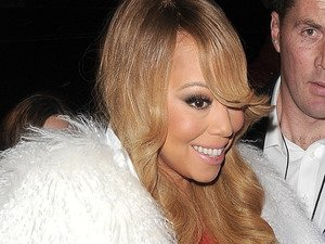 Mariah Carey makes a splash at her o2 gig in HUGE faux fur coat. You have to see it!