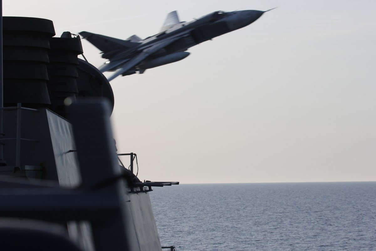 EUCOM releases photo of a Russian Su-24 attack aircraft making very-low altitude pass by the USS Donald Cook Tuesday https://t.co/n5F4g3XIK5