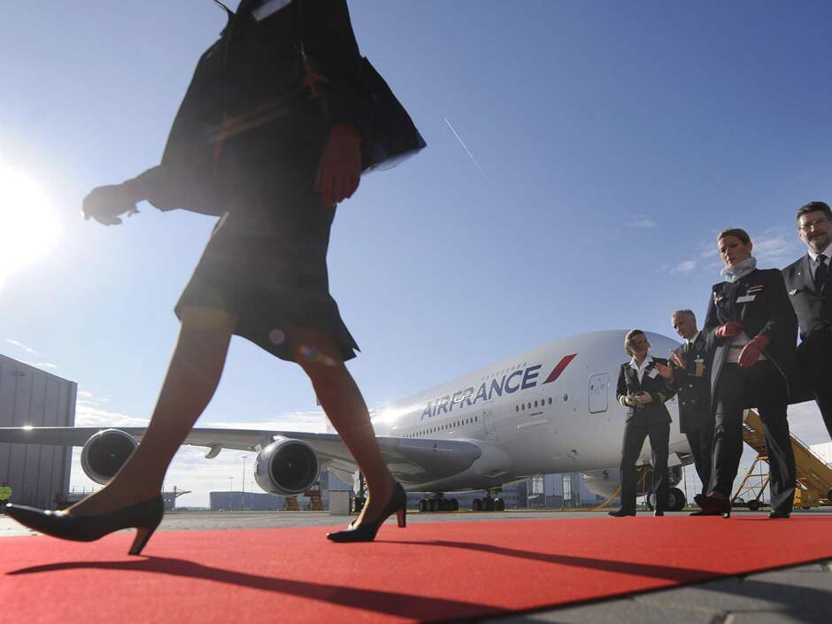 Air France flight attendants, upset at order to wear