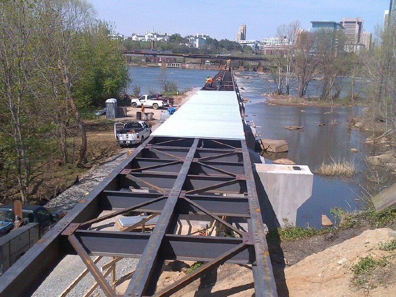 Installation of the decking begins on #tpottrva. Few more months before we can walk across the James on this! #rva https://t.co/HkzDegD5HQ