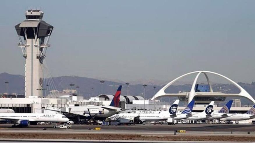 AIRPORT INSECURITY LAX baggage handlers accused of drug